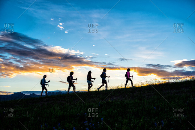 Silhouettes of women hiking