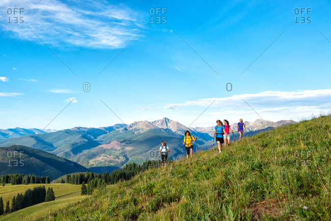 Women hikers on grassy hill top