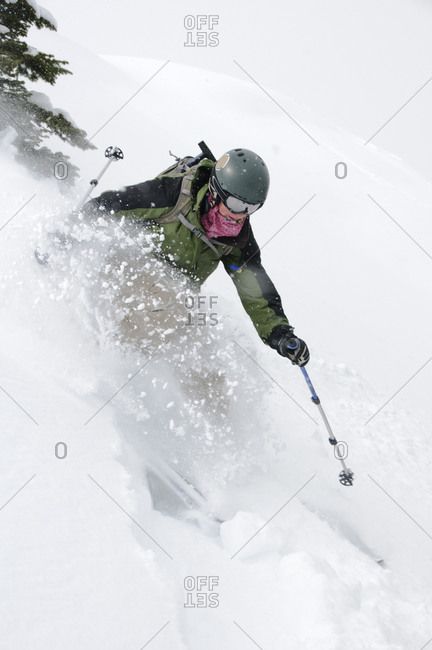 A female skier on the trail.