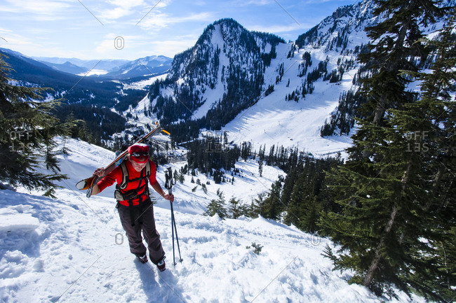 A female snow hiker boot packs up an icy section on Snoqualmie Peak.