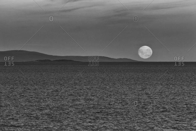 Moonrise over seascape in Antarctica