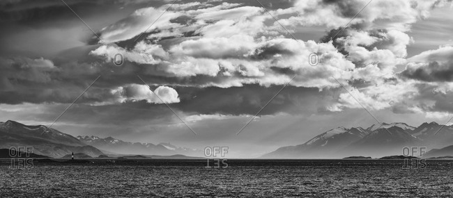 Dramatic cloudscape and sunbeams above Beagle channel, Antarctica