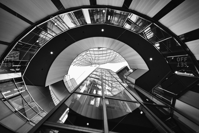 Low angle view on the spiral staircase at Cocoon Tower in Shinjuk, Tokyo, Japan