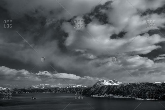 Panoramic view on Lake Mashu with dramatic cloudscape, Hokkaido, Japan
