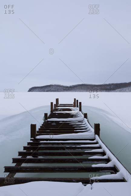 Jetty and frozen surface of Saroma lake in Hokkaido, Japan