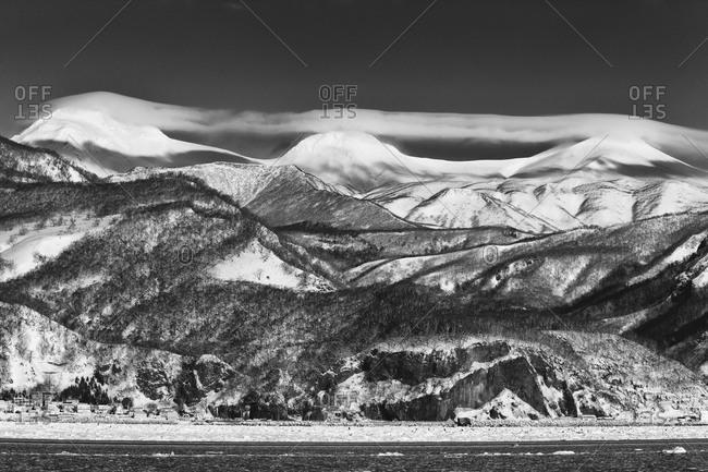 Shiretoko Mountains with lenticular cloud cover in island of Hokkaido, Japan.