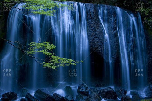 The Tatsusawa Falls photos at dusk with sprint leaves in Fukushima Prefecture, Japan.