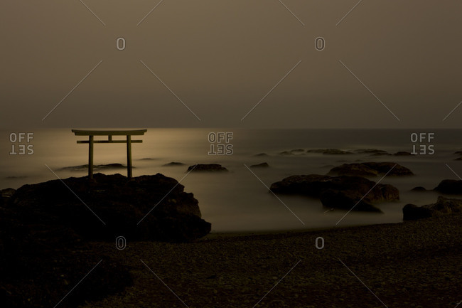 Moonlit seascape with Shinto Gate (Torii) at Ooarai, in Ibaraki prefecture, Japan
