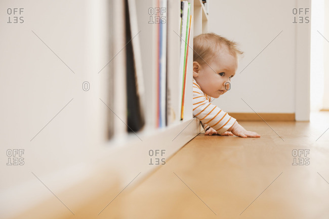 Baby in Bookshelf