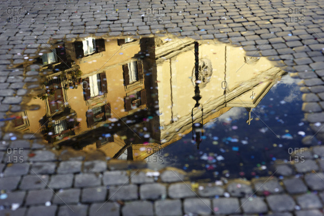 Confetti and Reflection of Building in Puddle, Piazza Navona, Rome, Italy
