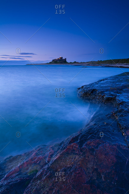 Bamburgh Castle and the North Sea, View From Harkess Rocks, Bamburgh, Northumberland, England, United Kingdom