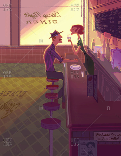 A customer and a waitress have a quiet chat in an old fashioned diner