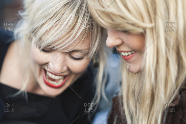 Cheerful female friends laughing