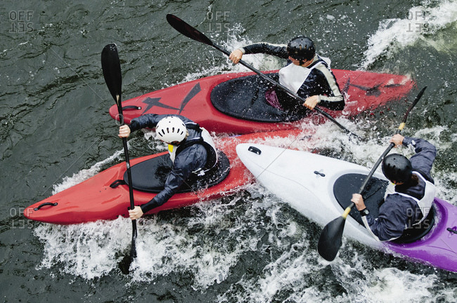 High angle view of people kayaking in rapid water