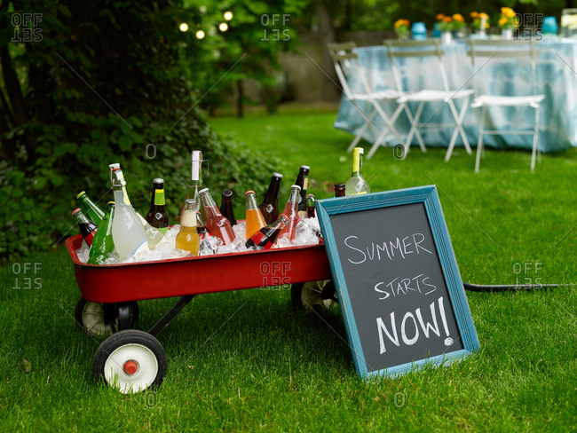 Outdoor wagon filled with ice cold bottled beverages