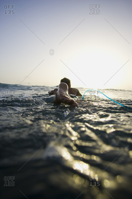 Rear view of man in water with rope