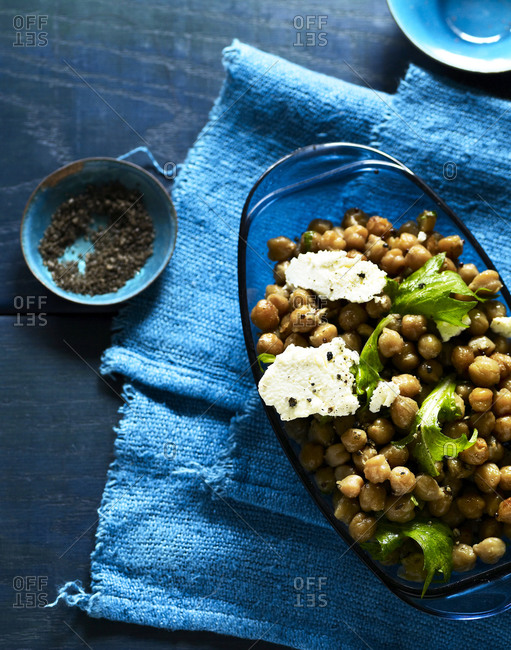Chickpea salad with lettuce and soft cheese.
