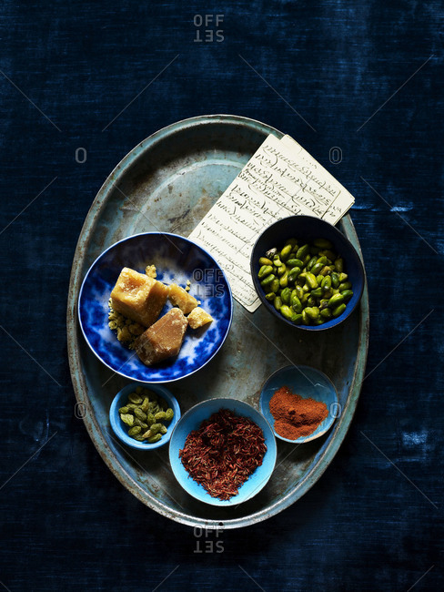 Top view of a plate of ingredients and spices.