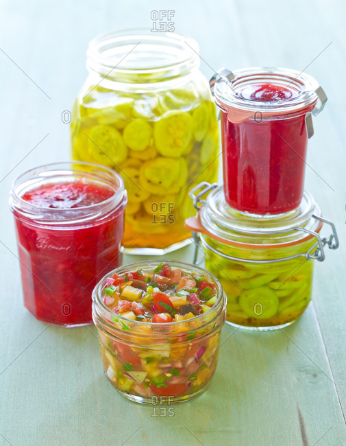 Raspberry Jams, Bread and Butter Pickles and Heirloom Tomato Salsa in Canning Jars