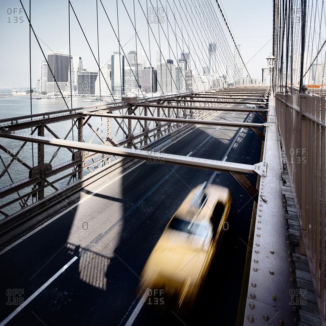 Yellow cab crossing the Brooklyn Bridge in New York City, Manhattan