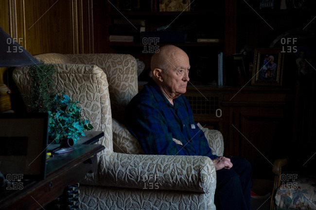 An elderly man sits in the den of a home in Lincoln, Nebraska