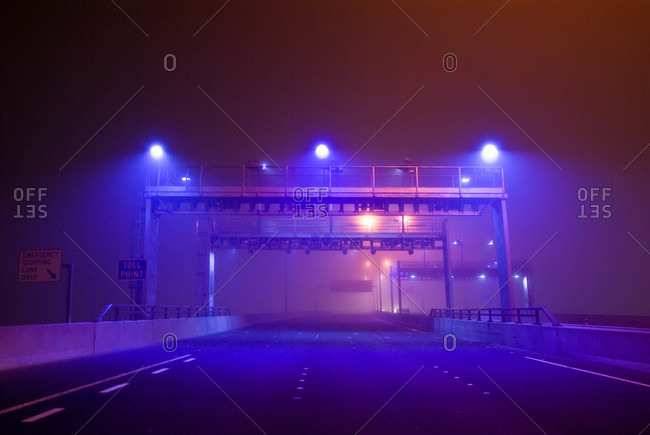 A gantry for detecting motor vehicles on a bridge emerges from the fog