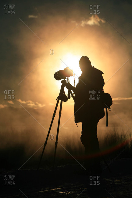 A photographer looks for his subject in Grand Teton National Park
