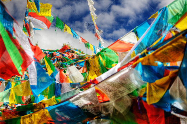 Prayer flags atop a mountain summit