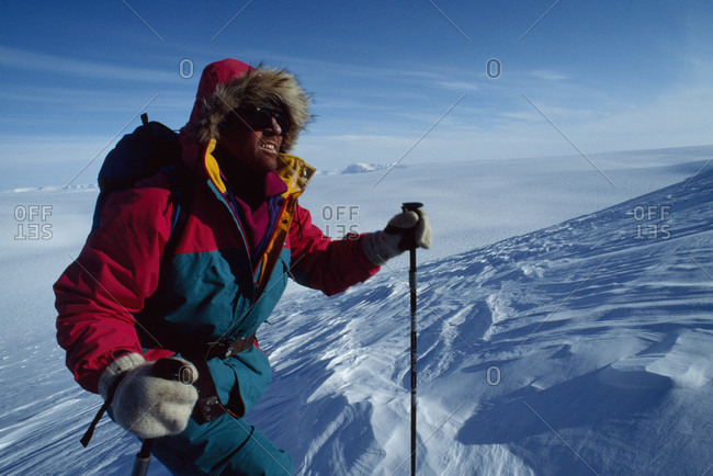 Exedition skier in wind-carved sastrugi snow above Lomonosov Icecap
