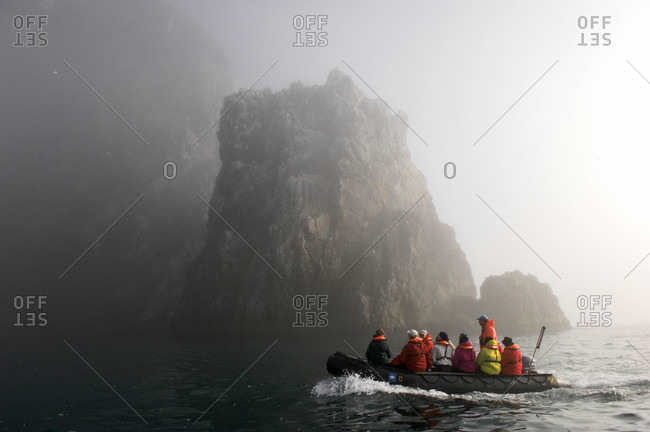 Norway, Tourists ride in  fog and zodiacs to study local wildlife, fog