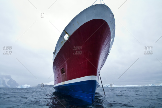 The enormous ice strengthened bow of an ecotourism ship in Antarctica