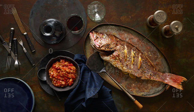 Whole fried red snapper with mango salsa