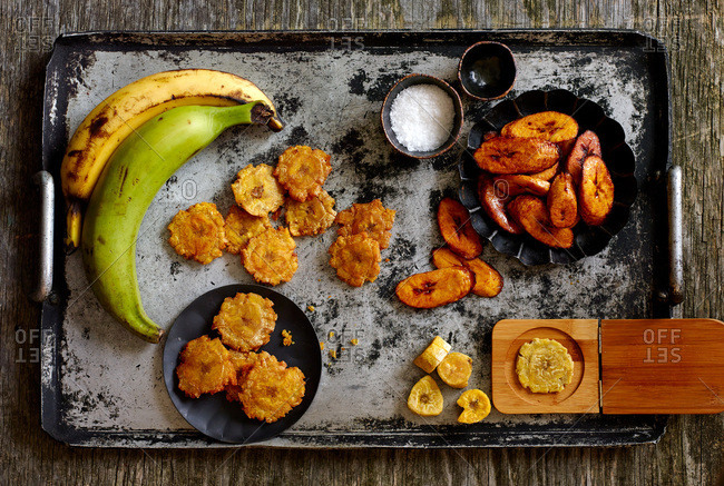 Overhead view of Cuban fried green plantains and maduros