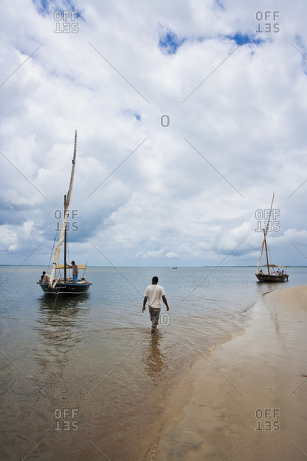 Two dhows on beach in Kenya