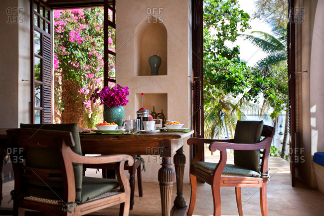 Set table for breakfast with opened patio doors