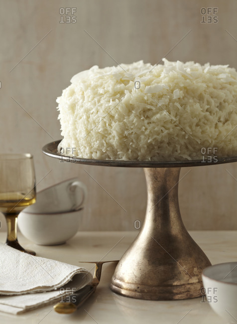 Coconut cream cake on a vintage cake stand