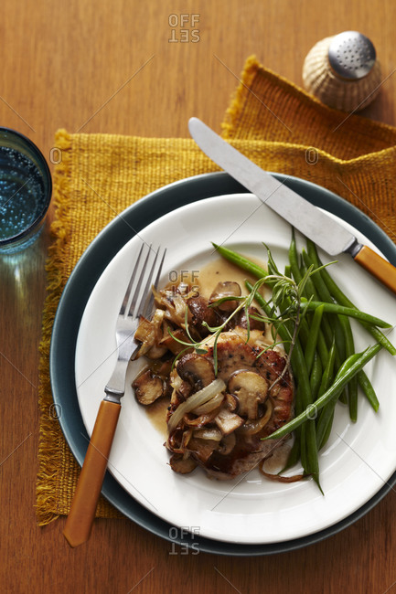 Pork chops with mushrooms, onions and green beans overhead