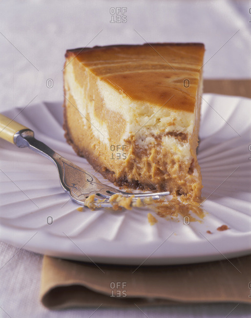 Piece of caramel cheesecake with mascarpone topping
