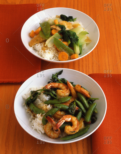 Shrimp and vegetable stir fry with snow peas, carrots, pak choi and jasmine rice