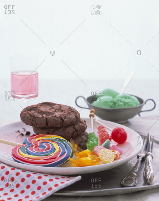 Junk food: chocolate cookies, candy, a giant lollipop and mint chocolate chip ice cream