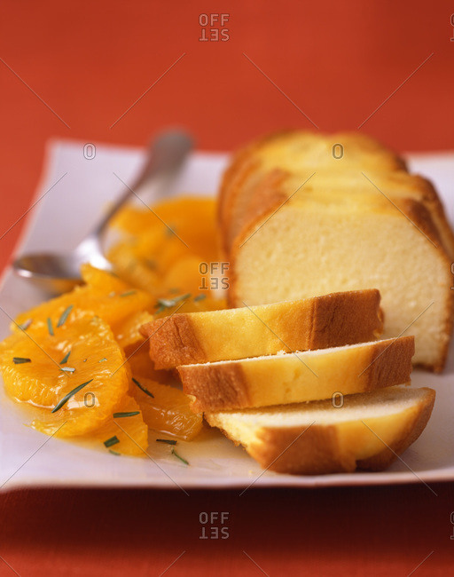 Canned sweet orange slices with herbs and slices from a loaf of shortcake bread for a dessert