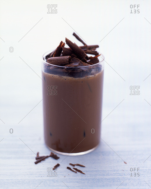 Chocolate milk topped with chocolate shavings