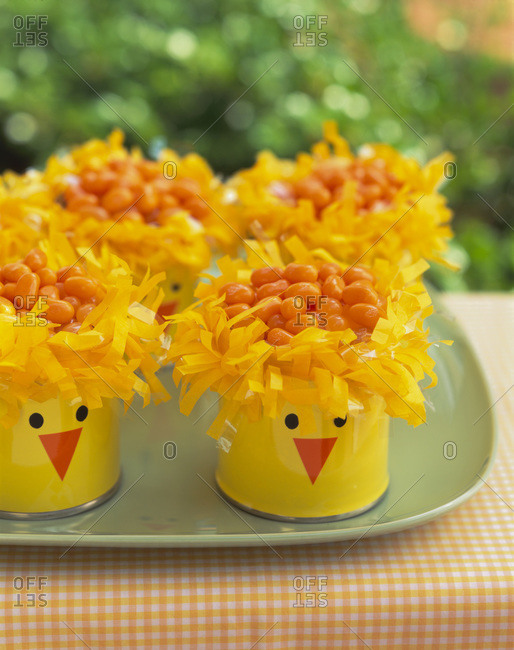 Easter chick cans with orange jelly beans inside