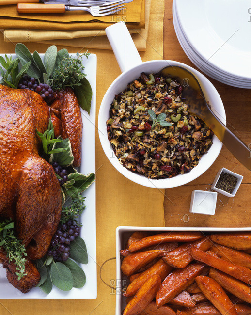 Roasted turkey with sweet potato wedges and wild rice