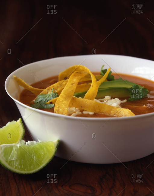 Spicy Mexican tortilla soup topped with tortilla strips