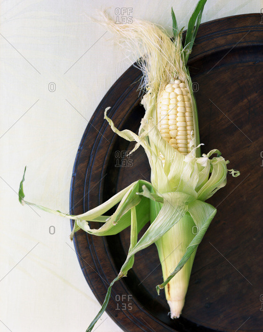 An ear of spring corn on a plate