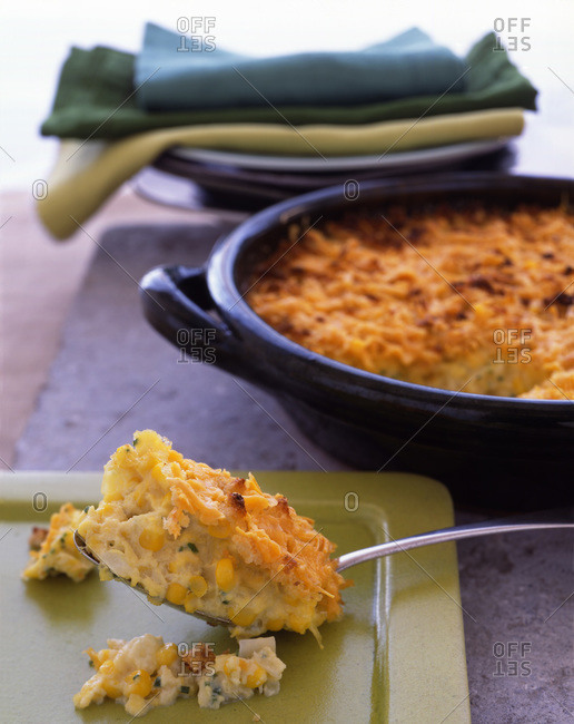 Sweet corn casserole with melted cheese