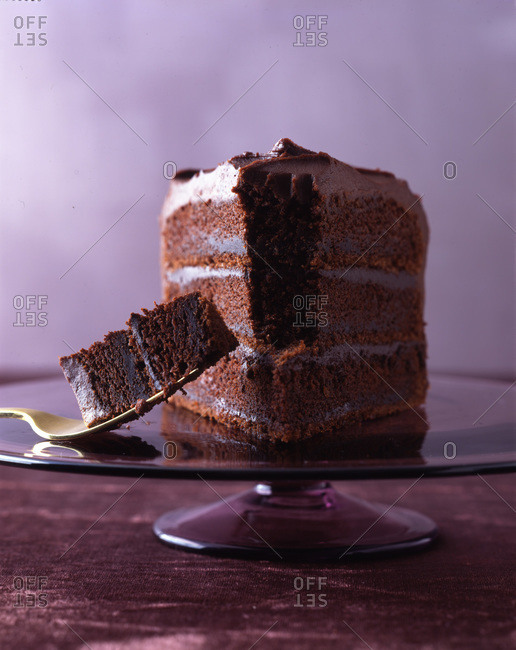 A slice of three-layer chocolate cake with blackout filling