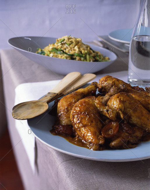 Broiled chicken legs served with rice for traditional Passover dinner