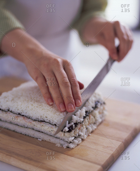 Hands of the woman preparing sushi at home